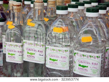 RETHYMNO, Crete, Greece - MAy 29, 2008: Bottles of raki, or tsikouthia, the traditional Cretan spirit, on sale in Rethymno