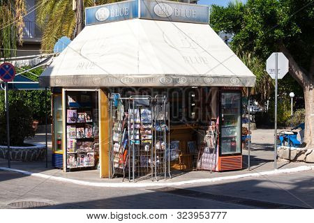GALATAS, GREECE - October 25, 2012: A traditional periptero Greek cigarette, news and drinks stand in Galatas village, opposite Poros, in the Argo-Saronic gulf