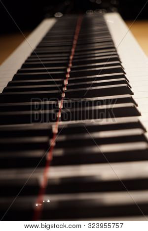 Close-up Of Piano Keys. Black Grand Piano Keyboard