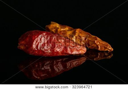 Group Of Two Whole Dry Red Chili Pepper Peperoncino Isolated On Black Glass