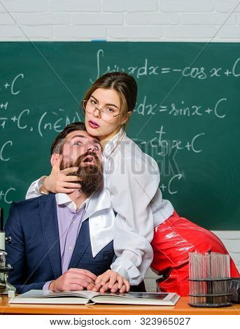 Desire and love. Couple in love in school. Sensual couple in love. Bearded man submit under sexy woman. Love to dominate poster