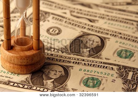 Sand passing through timer on American banknotes poster