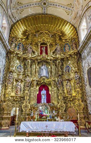 Oaxaca, Mexico - January 5, 2019 Basilica Golden Altarpiece Christmas Creche San Felipe Neri Church