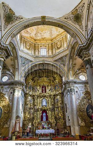 Oaxaca, Mexico - January 5, 2019 Basilica Golden Altarpiece Christmas Creche Dome San Felipe Neri Ch
