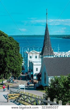 Mackinac Island Mi /usa - July 9th 2016: Behind Saint Annes Church Walking Toward Downtown Mackinac
