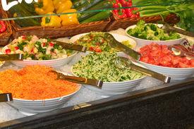 Salad Bar With Fresh Vegetables On Ice Closeup