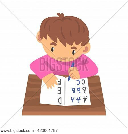 Cute Little Boy Learning To Write, Elementary School Student Sitting At His Desk And Writing Cartoon