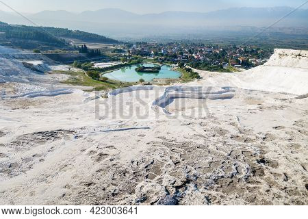 Panoramic View Onto Famous Travertine Terraces Of Pamukkale, Turkey. Artificial Lake With Green & Bl