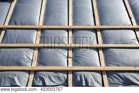 New Roof Coverings With Insulation, Isolation Tiled Roof, House Renovation Close-up Background Of In