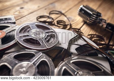 Retro audio reels, cassette tape and retro microphone music background