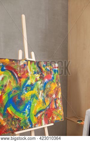 Oil painting and wooden chair. Art still life and paintbrush painting in artist creative studio interior with painter tool