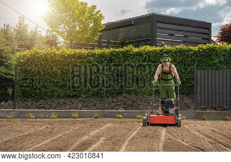 Gardening And Landscaping Industry Theme. Lawn Aeration And Preparing For Grass Seeding By Professio