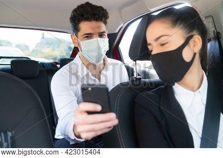 Man Showing Something On Phone To Cab