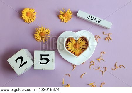 Calendar For June 25: The Name Of The Month Of June In English, Cubes With The Number 25, A Cup Of T