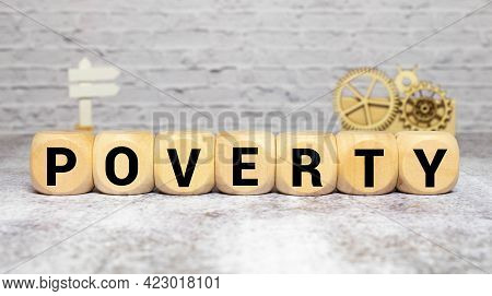 Poverty Word Written On Wood Block. Poverty Text On Wooden Table For Your Desing, Concept.