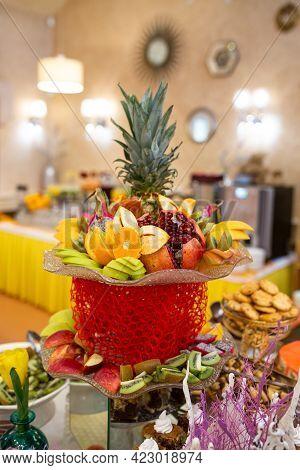Fruit Basket On The Table In The Restaurant Establishment.