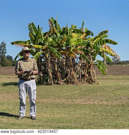 Mackay, Queensland, Australia - June 2021: Senior Male Retiree Learning To Fly A Drone On A Rural Pr