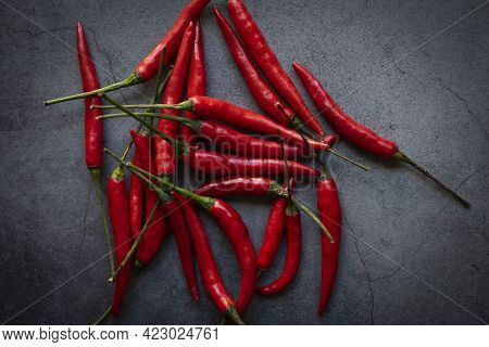 Hot And Spicy Chili Pepper On Dark Background, Red Chilli From Thailand
