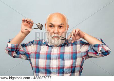Portrait Of Stylish Man Bearded Man With Grey Moustache Beard Hold Scissors And Straight Razor Hair