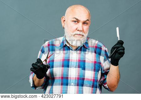 Middle Aged Man, Barber Holding Barber Equipments, Isolated On Grey Background. Barber Shop Barbersh