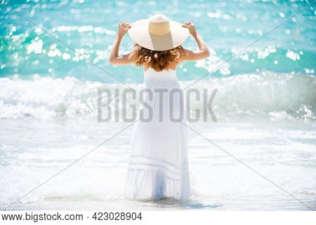 Back View Of Young Attractive Girl With Perfect Body On The Tropical Summer Beach. Sexy Woman On Sea