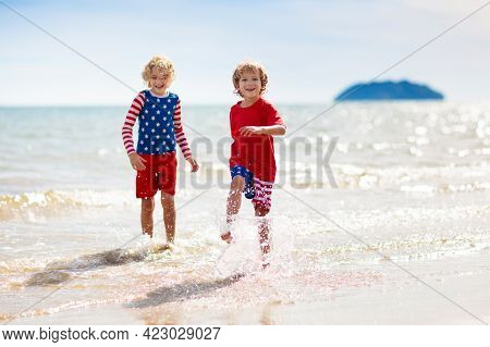 Kids With American Flag On Beach. 4Th Of July.