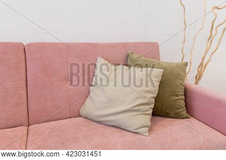 Living Room Furniture. Comfortable Couch With Pillows. Modern Room With Pink Sofa And Row Of Pillows