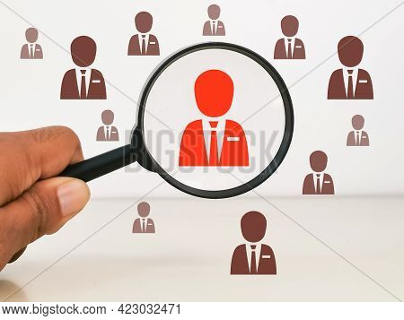 Headhunting And Choosing Good Employee Concept. Employee Icons With Hand Holding Magnifying Glass.
