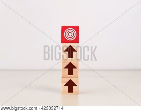 Wooden Cubes With Arrow Aiming To Goal Target. Target And Focus Concept.
