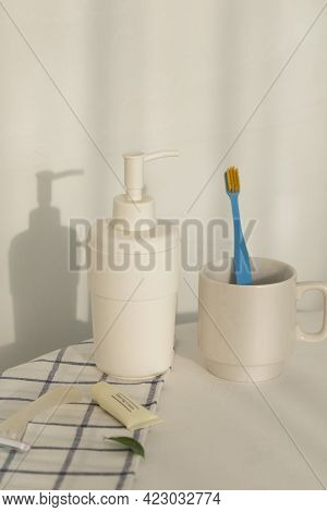 Toothbrush In Plastic Cup Isolated On White Background.