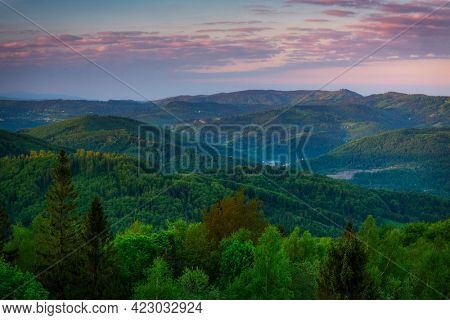 Panorama of the Silesian Beskids from Rownica peak at sunrise. Poland