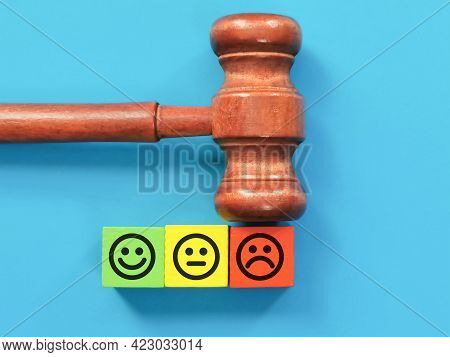Law Enforcement Satisfaction Survey Concept. Emotional Face On Colorful Wooden Cubes With Gavel.