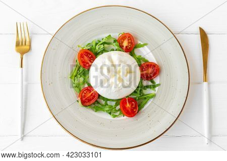 Salad With Burrata Cheese And Cherry Tomatoes On White Wooden Background
