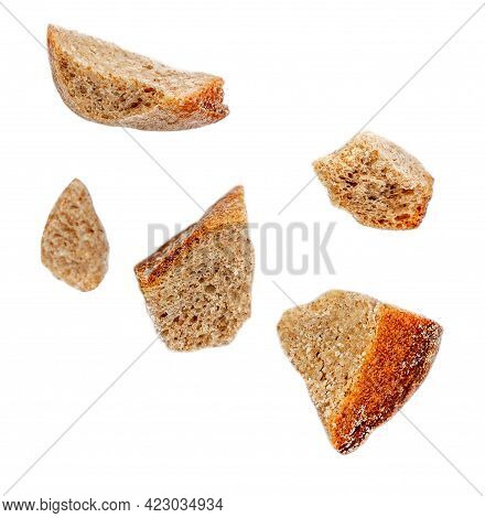 Flying Bread Pieces Isolated On White Background.  Bread Crumbs Macro.