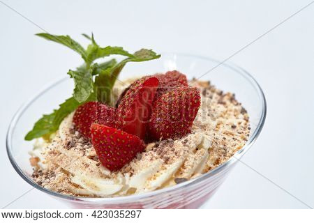dessert with strawberries and cream