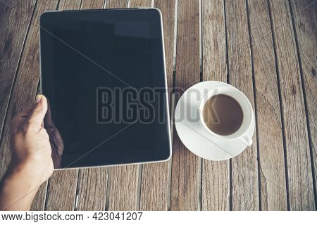 Top View Man Hand Overhead Office Desk Laptop, Coffee Cup On Wood Table Copy Space. Tabletop Noteboo