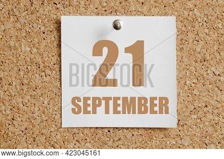 September 21. 21th Day Of The Month, Calendar Date.white Calendar Sheet Attached To Brown Cork Board