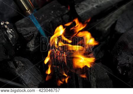 Burning Charcoal Close Up. Coal Lump On Gas Flame. Camp Fireplace Fuel For Meat Cooking. Natural Dar