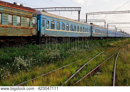 Transport - Side View On The Old Passenger Railroad Cars Train With The Broken Windows.