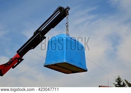 Waste Recycling In Separated Waste Containers. The Lower Lid Opens While The Crane Is Stretched Over