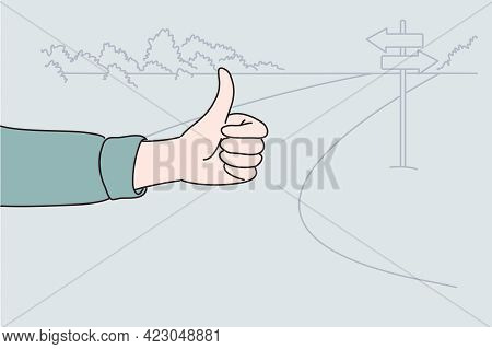 Hitchhiking, Hitching, Thumbing Concept. Human Hand Showing Thumbs Up Sign During Travel, Trip, Vaca
