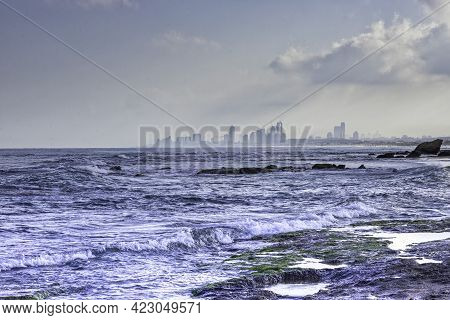 View Of The City In The Fog From The Side Of The Sea Coast