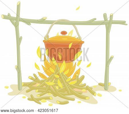 Cooking Dinner In A Small Tourist Pot Boiling Over Burning Campfire In A Forest Camp On Summer Vacat