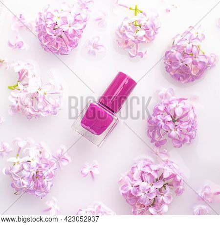 Lilac Nail Polish And A Branch Of Lilac . A Bottle Of Nail Polish Without A Name. The Concept Of Adv