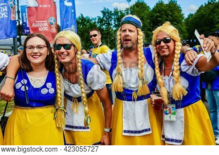 St. Petersburg, Russia - July 3, 2018: Group Of Happy Swedish Fans Wearing National Costumes Of Yell