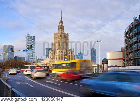 High Traffic Near The Palace Of Culture And Science In Warsaw, Poland. Long Exposure Shot Of City Li