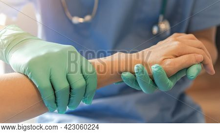Surgeon, Surgical Doctor Holding Patient Hand In Professional Er Emergency Operation Room For Health