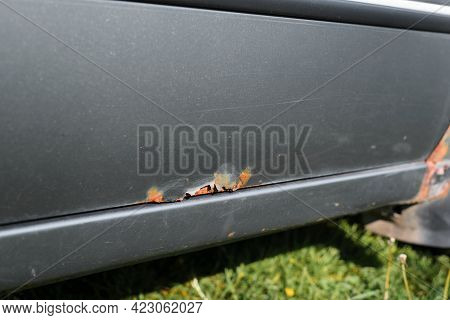 Corrosion And Rust Of The Car. Close-up Of A Rusty Door. Car Problems Concept