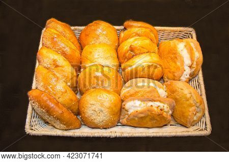 Pies, Buns, Juicy Cakes With Cottage Cheese, Croissants On An Openwork Wicker Basket Of Rectangular