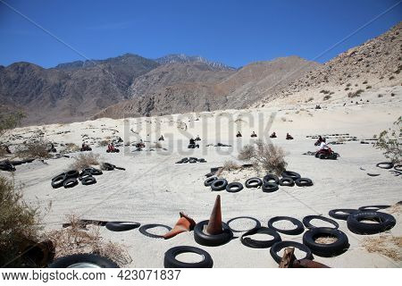 Palm Springs, California USA. June 6, 2021: Quad Bike Rental Track. Quad bikes are being driven by renters on a Quad Track. Entertainment for adults - race in rough terrain, mud and sand dunes.